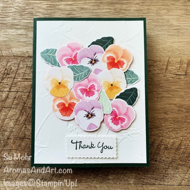By Su Mohr for FMS; Click aromasandart to go to my web site for details! Featuring: Pansy patch Stamp Set, Pansy Dies, Painted Texture embossing, Stitched So Sweetly Dies;#handmadecards #handcrafted #diy #cardmaking #papercrafting #stampinup #sumohr #aromasandart #aromasandart.com/shop #cardinstruction #pansypatch #pansydies #paintedtexture #pansies #flowersoncards #2021-2022stampinup