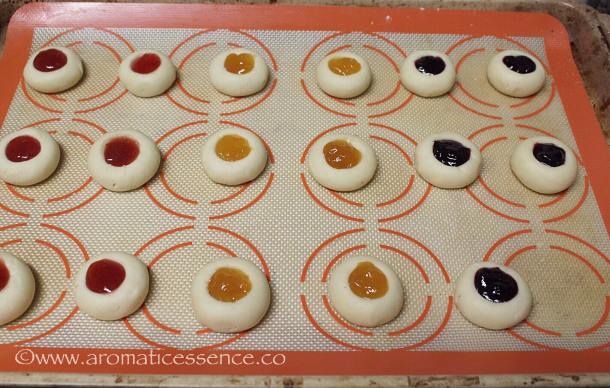 Fill the centers of the cookies with jam right up to the brim