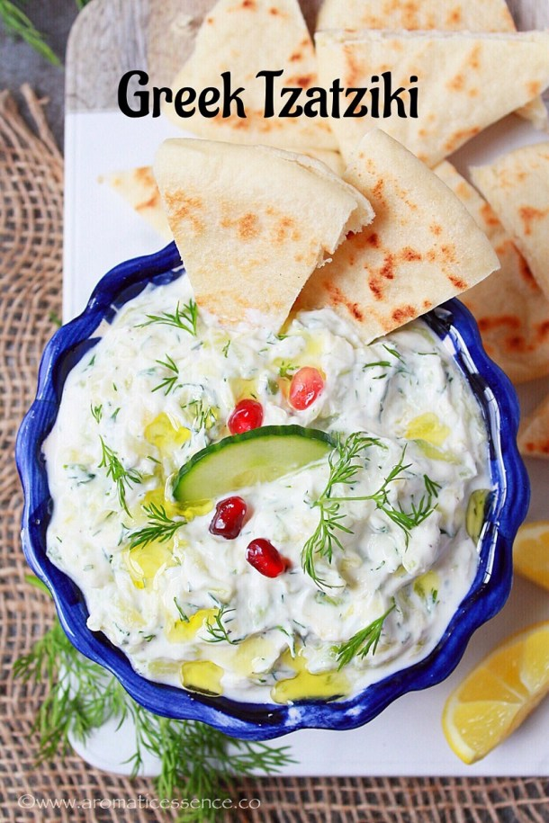 Tzatziki sauce in a bowl with pita bread