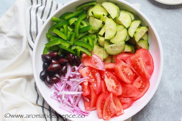 Veggies and olives for Greek salad in a shallow bowl