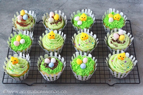 Easter cupcakes topped with chocolate eggs and chick toppers