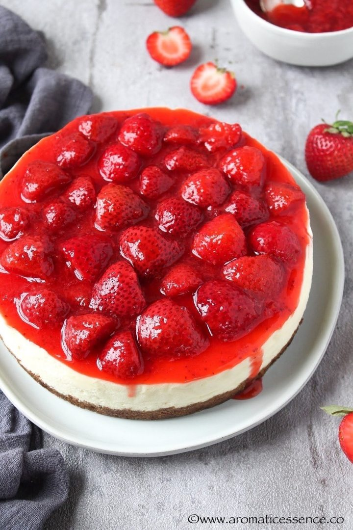 Instant Pot cheesecake topped with fresh, homemade strawberry sauce.