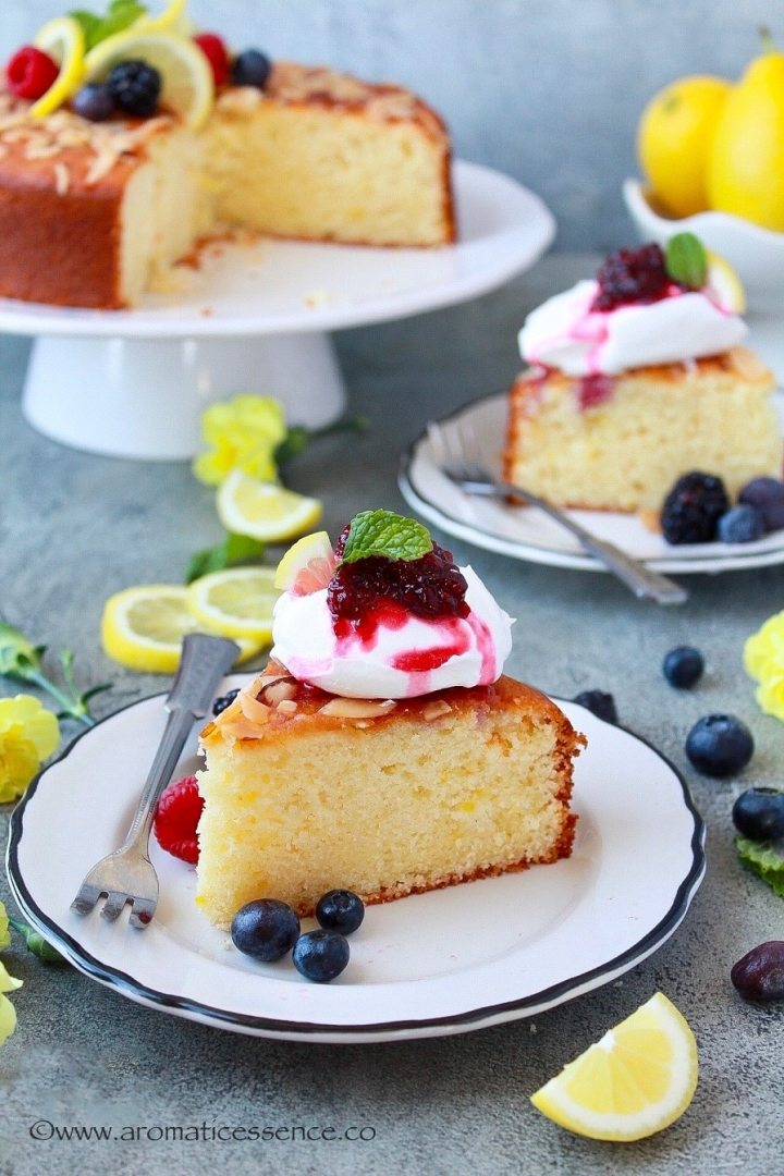 Two slices of lemon and ricotta cake served on white plates