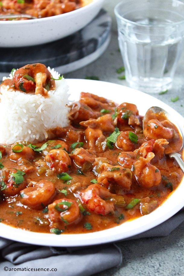 Close-up shot of crayfish etouffee in a white plate