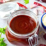 Red enchilada sauce in a jar