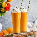 Mango milkshake served in two tall glasses