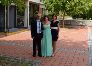 Sarah with her parents at her school graduation