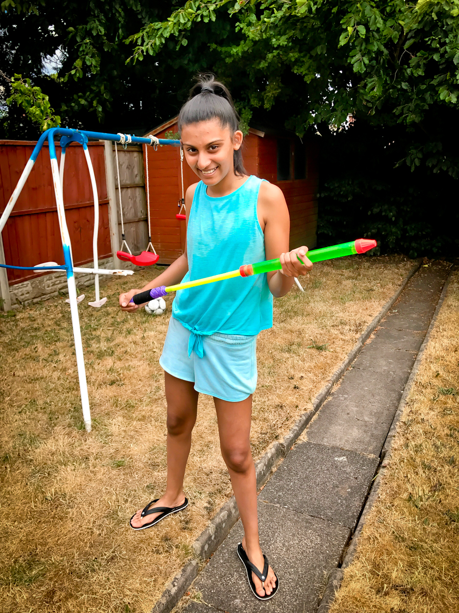 Shalini gears up for a water fight with her chosen weapon