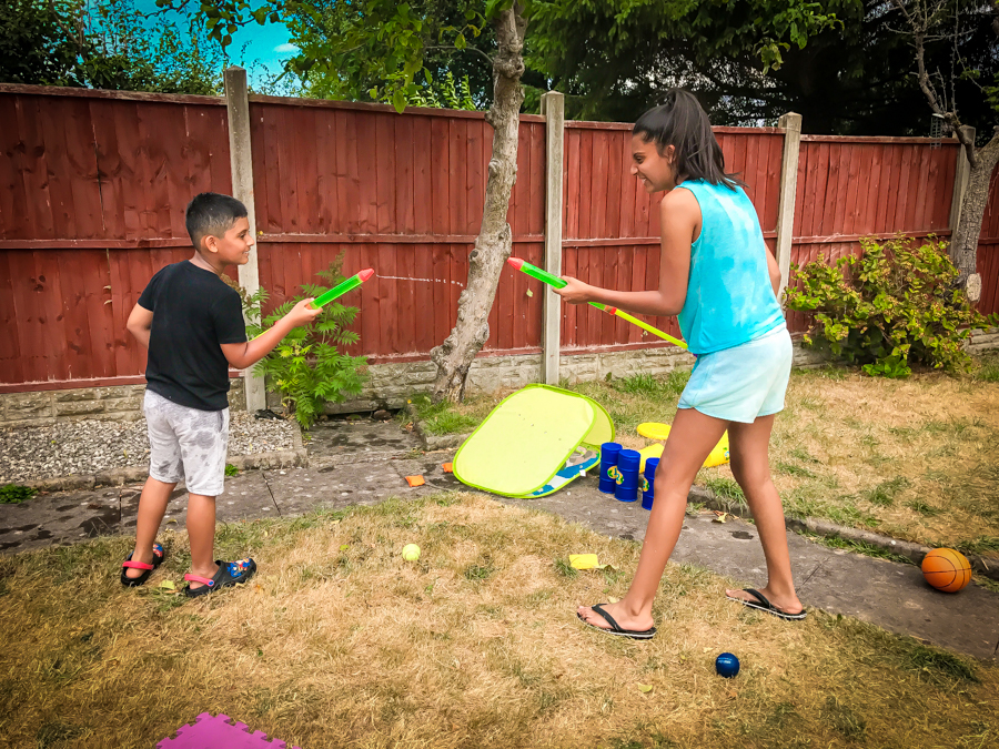 Shalini and Shivam facing off in a water fight
