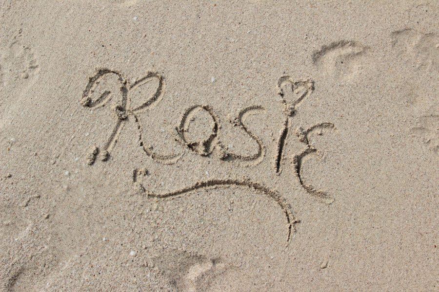 Rosie written in sand