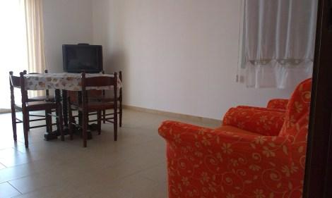 casa_vacanza_terranova_soggiorno_tv
