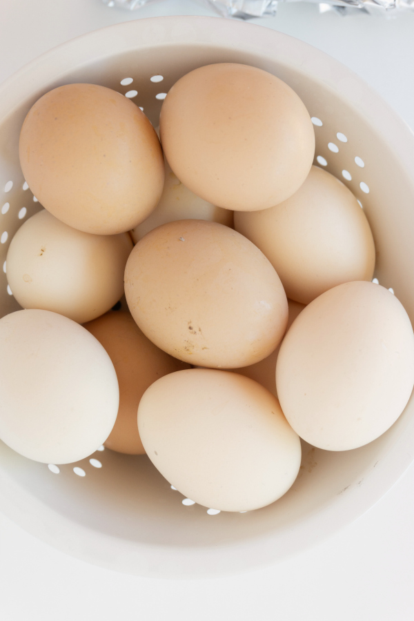 in-shell brown eggs stacked in colander