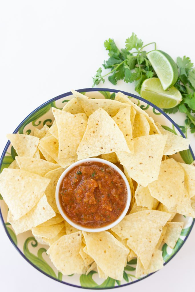 the best salsa recipe in a serving dish on platter with chips for dipping