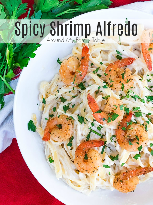 The addition of spicy shrimp to fettuccine alfredo turns basic alfredo into a hearty meal.  Spicy Shrimp Alfredo is a great weeknight family meal. #fettuccinealfredo #spicyshrimp #grilledshrimp #shrimpalfredo via @slingmama