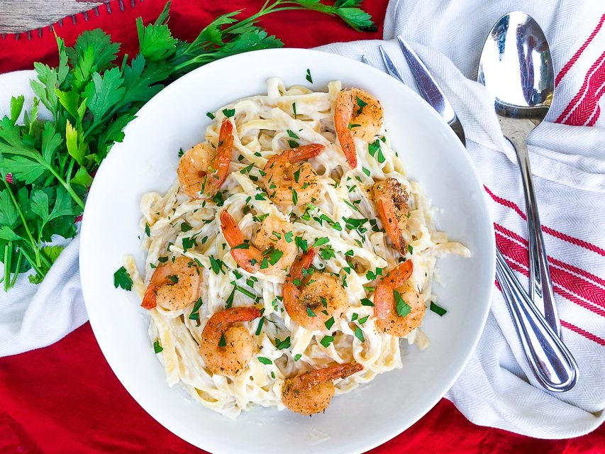 spicy shrimp alfredo in a white bowl