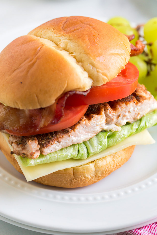 grilled blackened salmon BLT sandwich on ciabatta roll