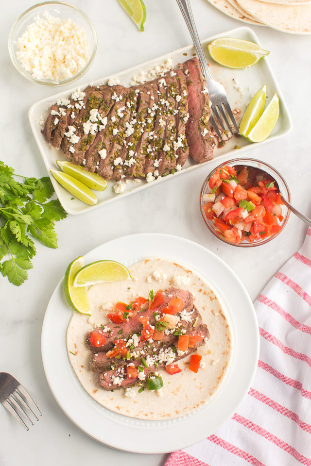 photo shows how to make street tacos: flour tortilla topped with steak street taco mixture
