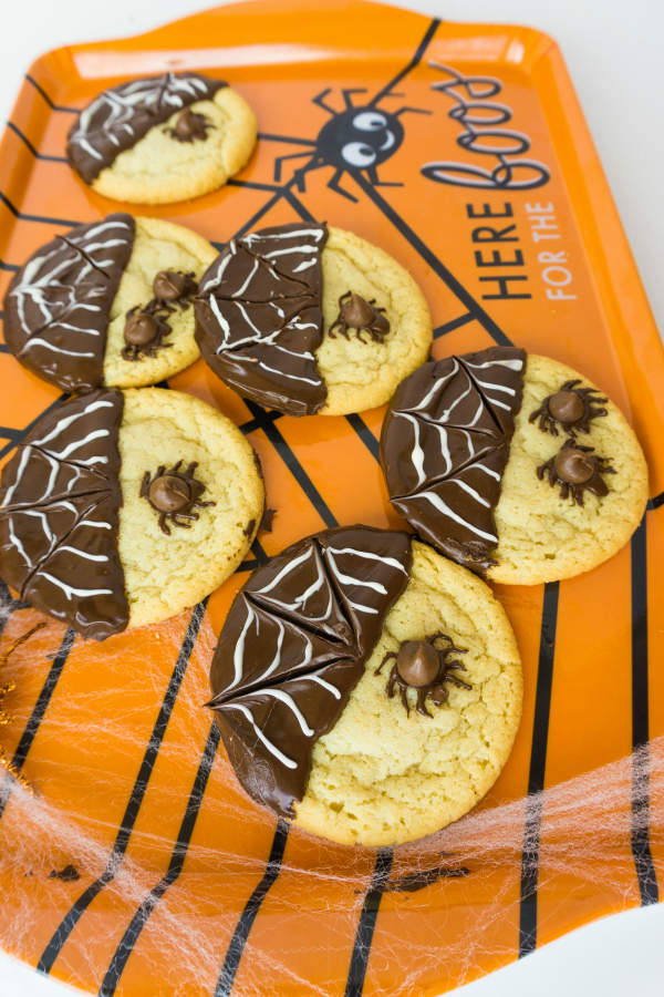 spider cookies on orange platter