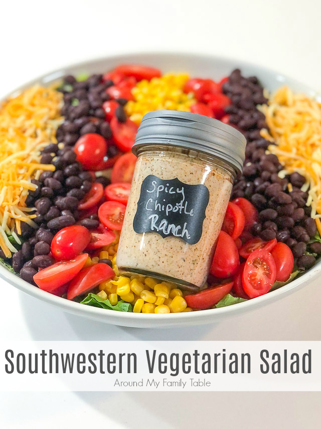 This simple Southwestern Vegetarian Salad has a ton of flavor from beans and corn, but the spicy chipotle ranch really takes it up a notch. via @slingmama