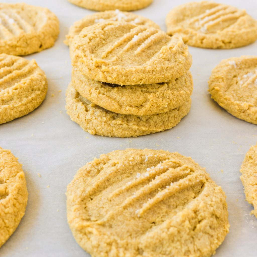 stacks of gf peanut butter cookies on counter top