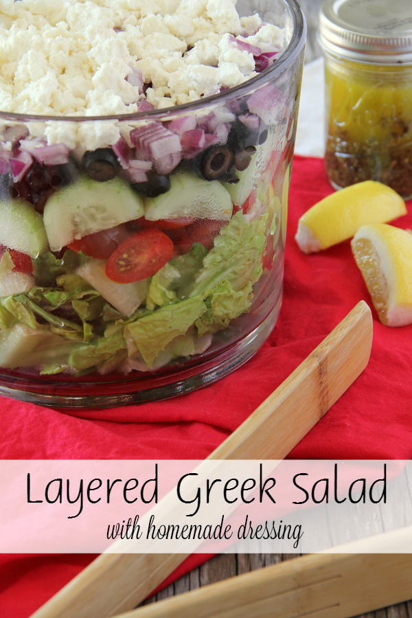 Serve this Layered Greek Salad for supper this week and it will be devoured in no time! Everyone loves how beautiful it is!