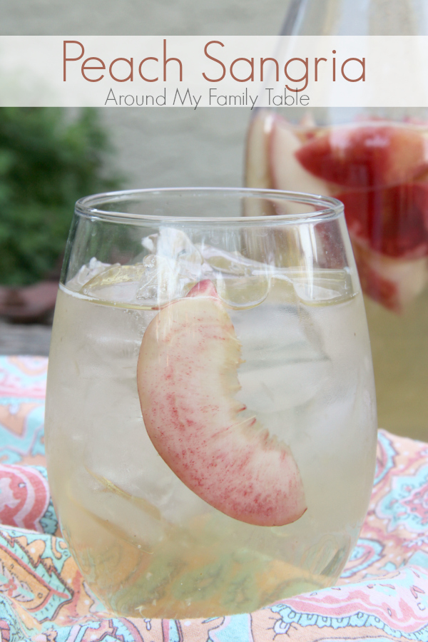 Sip on this refreshing PEACH SANGRIA all summer long. Only 4 simple ingredients and tons of peachy goodness!