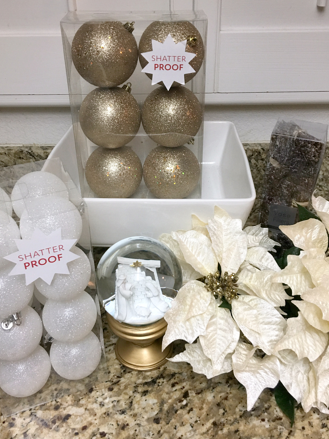 A simple Christmas Centerpiece is all you need for your table to add a little holiday cheer to your dining room.