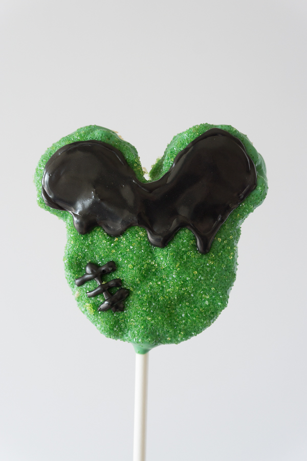 Love this Mickey Frankenstein Crispy Treat! You won't believe how simple and easy these Homemade Disney Halloween Mickey Crispy Treats are to make.