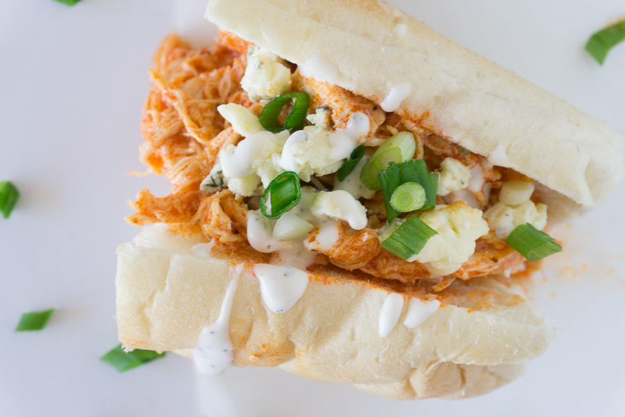 These spicy Slow Cooker Buffalo Chicken Sandwiches are sure to be the hit of any party.  They are perfect for homegating parties, holiday parties, or just for an easy supper.