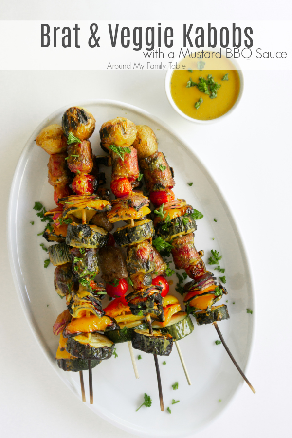 Fire up the grill for these Brat & Vegetable Kabobs with Mustard BBQ Sauce.  The Mustard BBQ sauce adds a tangy twist to the kabobs.  It's the perfect glaze for the brat kabobs since nothing pares better with a grilled brat than some yellow mustard.