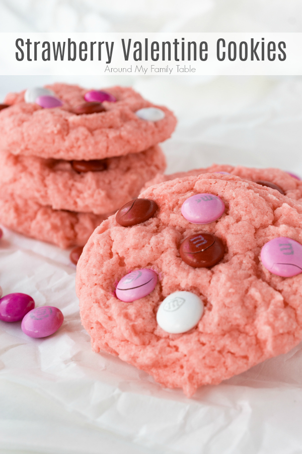 Celebrate your love with a batch of Strawberry Valentine Cookies. These cake mix cookies have a light strawberry flavor and topped off with valentine chocolate candies, sort reminds me of chocolate covered strawberries.
