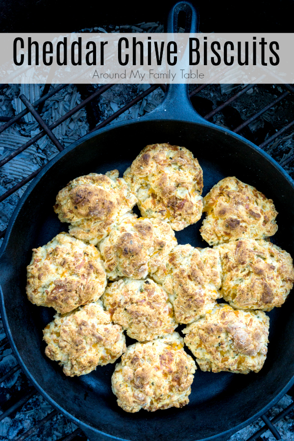 I've kicked up my traditional buttermilk biscuits and added loads of cheddar and chives.  My Cheddar Chive Biscuits are absolutely mouth watering whether cooked in the oven or over a campfire. #castiron #campingrecipes #camping #biscuits #cheedarchive #dropbiscuits #castironrecipes