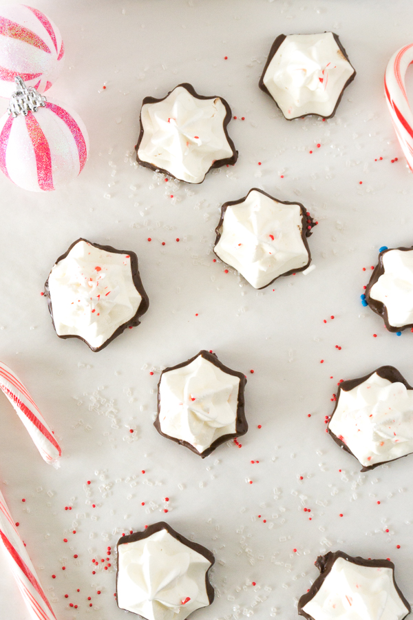 star shaped peppermint meringues on white parchment paper