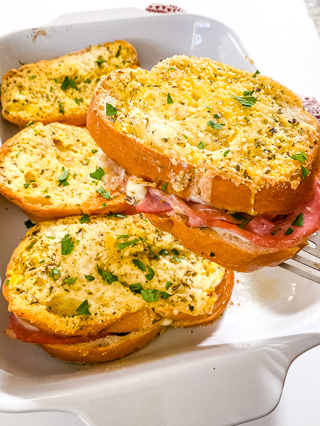 baked italian sandwiches in white dish