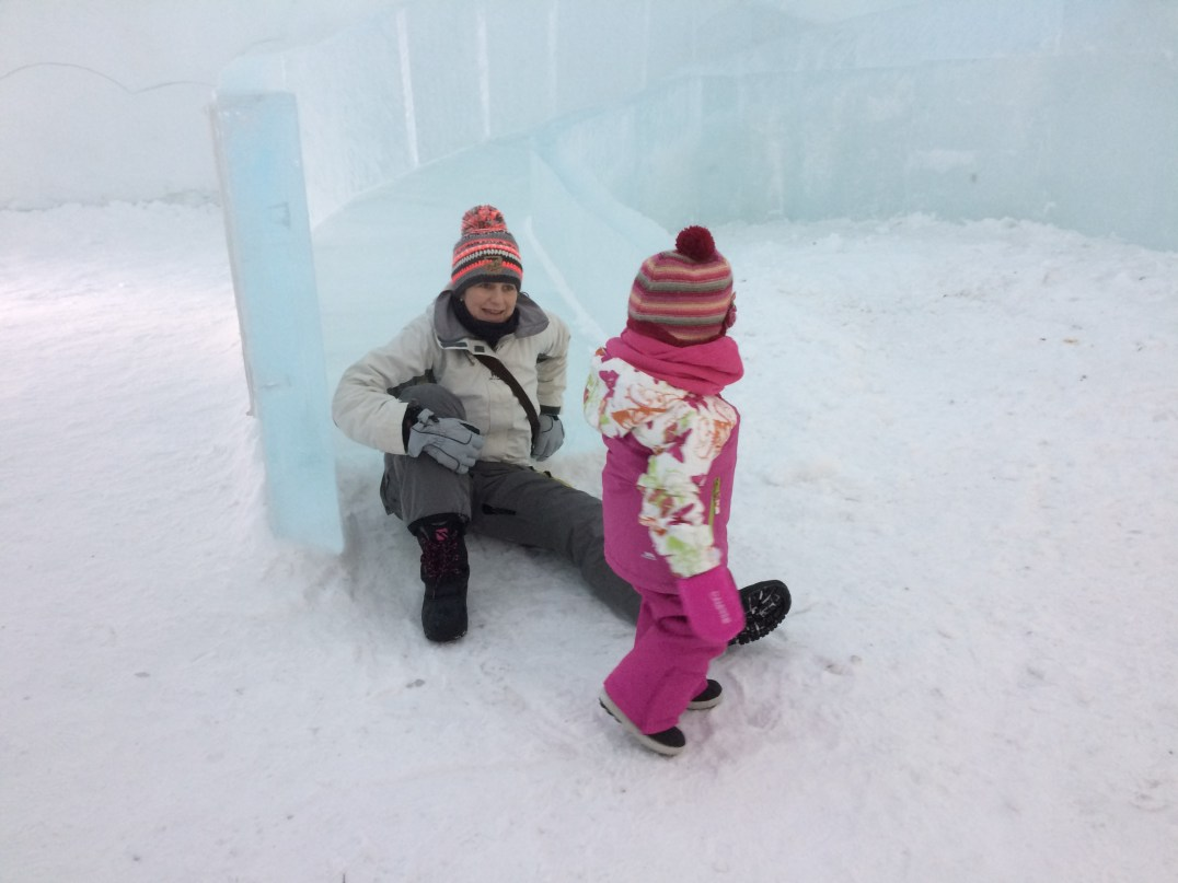 Enjoying the slide at Snowman World in Santa Claus Village, Rovaniemi