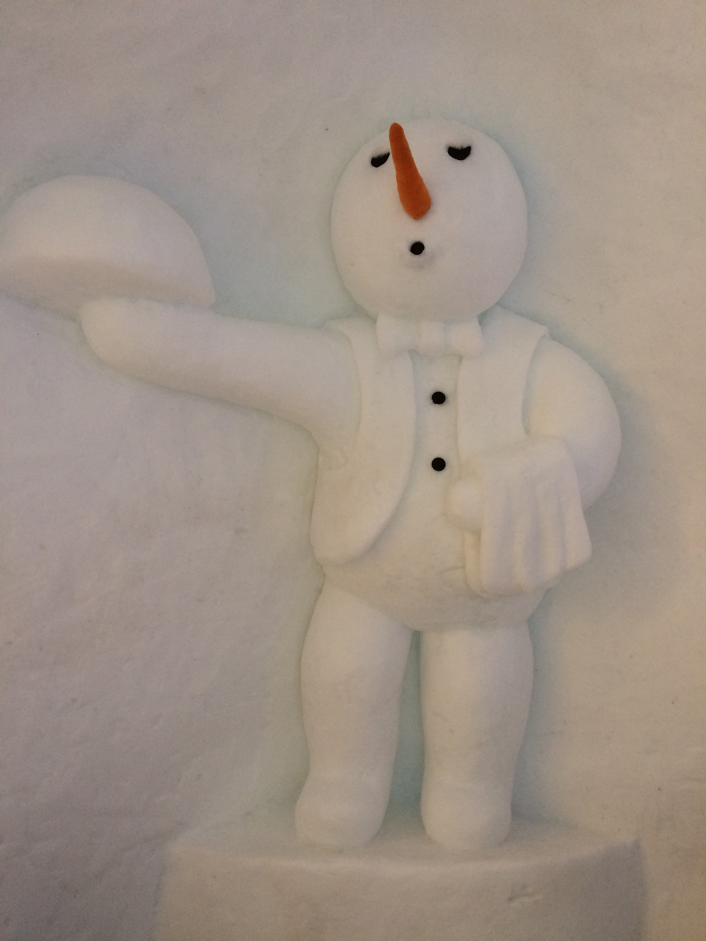A Snowman Butler serves guests at the Ice Hotel in Rovaniemi, Lapland