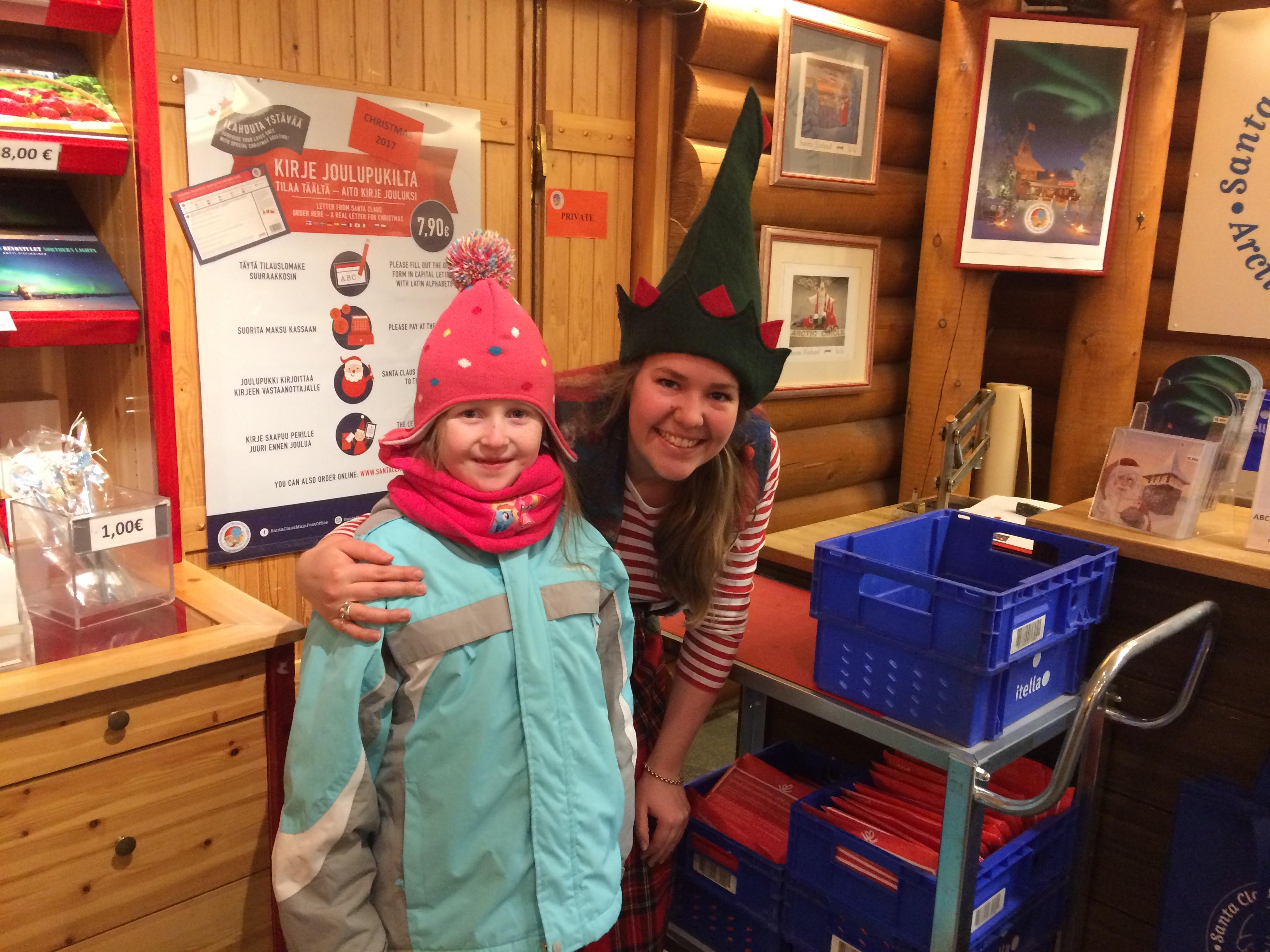 An Elf greets us inside Joulupukin Pääposti at the Santa Holiday Village in Rovaniemi, Finland
