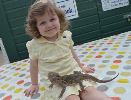 Matilda holds Sandy the bearded dragon at Alcorn's Tropical World in Letterkenny, Ireland
