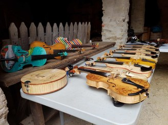 A selection of violins at the 26th Annual Bluegrass Festival In Omagh