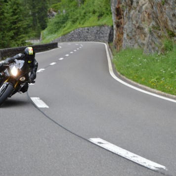 A motorbike rider negotiating the twisty road that is the Susten Pass