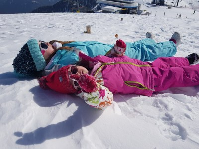 Making snow angels at Ski Center Latemar in the Val di Fiemme