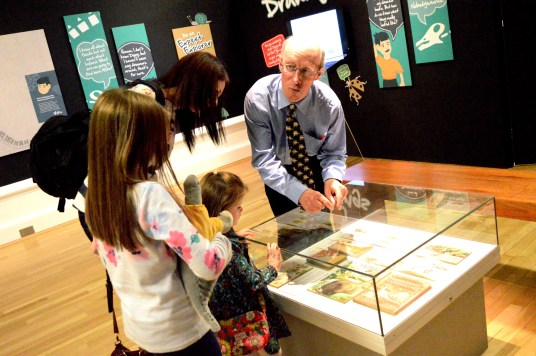 Dr Mike Simms showing a collection of his childhood books on display at the Ulster Museum, Belfast