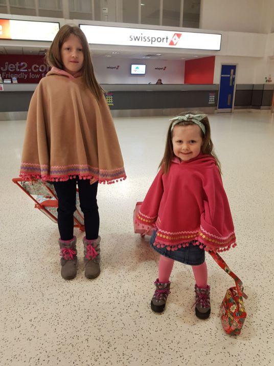 The girls making their waythrough Belfast International Airport