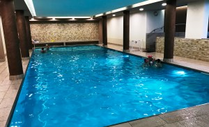 Spacious swimming pool at Aparthotel des Alpes in Cavalese