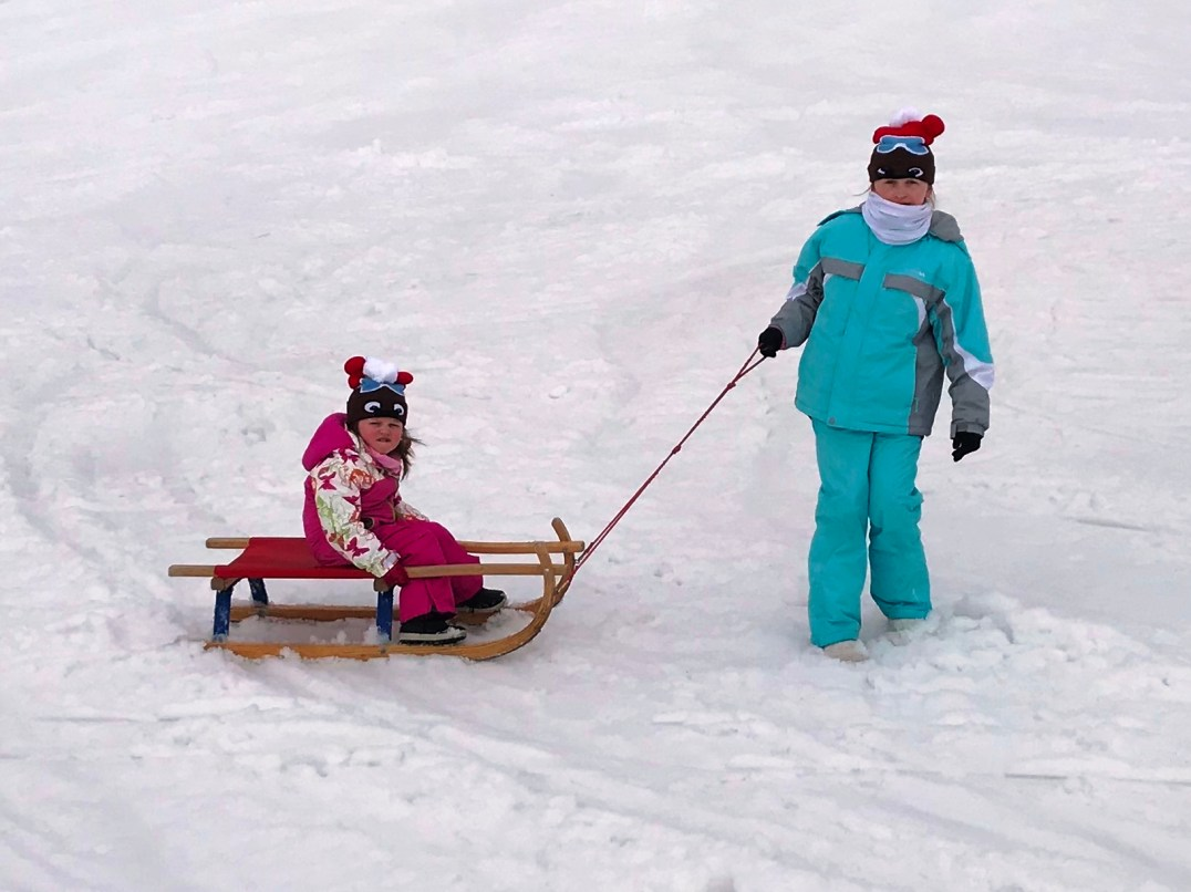 Matilda and Lily-Belle enjoying the tobogganing at Obereggen in the Dolomites