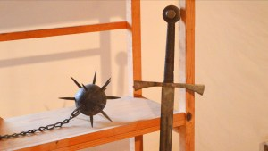 A Medieval flail and sword on display at Predjama Castle in Slovenia