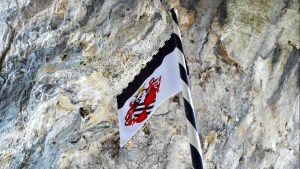 Predjama Castle flag flies proud