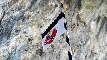 Predjama Castle flag flies proud