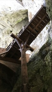 Wooden gangway leading into the cave at Predjama Castle, Slovenia