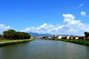 Arno River flowing through Pisa, Italy